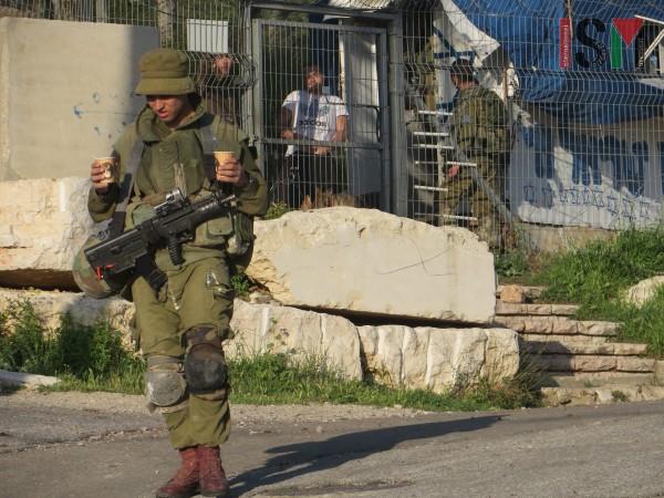 Illegal settler and Israeli soldier