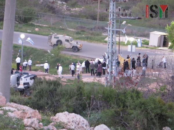 Settlers gathering on the Jabari family land with police protection