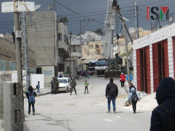 Israeli forces stopping school-boys on their way home, denying them passage