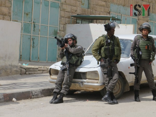 Israeli forces threatening to shoot tear gas at school-boys denied passage on their way home