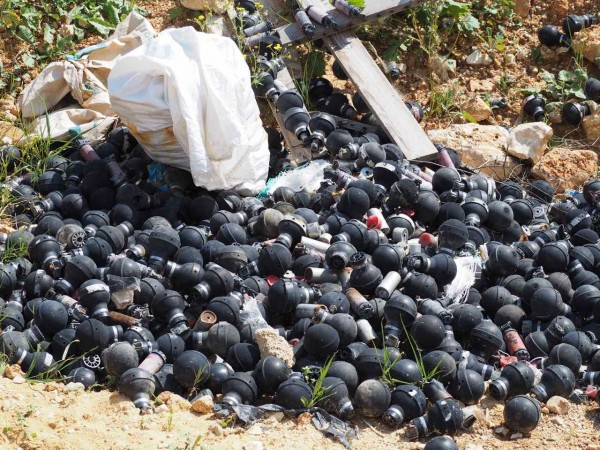 Piles of used tear gas grenades from past demonstrations