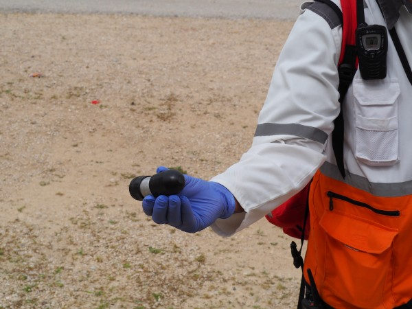 A red crescent medic shows the lethal tear gas canisters that are being used