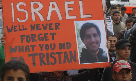 Protesters hold up a sign for Tristan