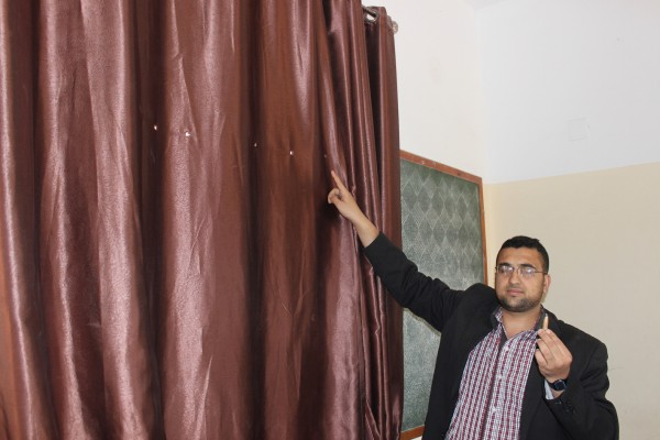 Bilal Abu Asser shows the bullet