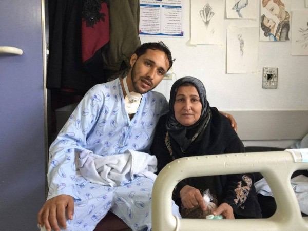 Mahmoud and his mother in hospital