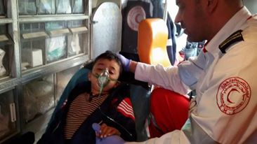 Young boy that was playing in park receiving treatment