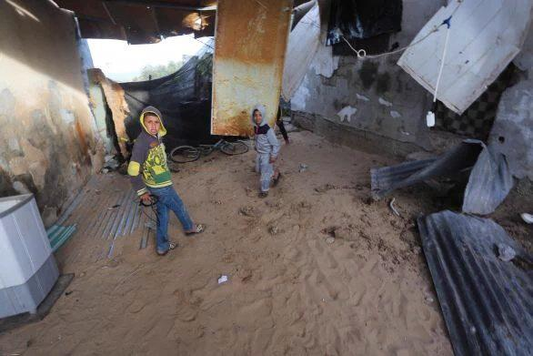 Children in the war torn buildings left by Israeli forces