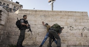 Young men are constantly being stopped, interrogated and searched by occupying forces in front of Damascus Gate and in the old city.  In the top left corner you can see a snipers post on a building overlooking Damascus Gate.  This post was placed without permission from the Palestinian owners.