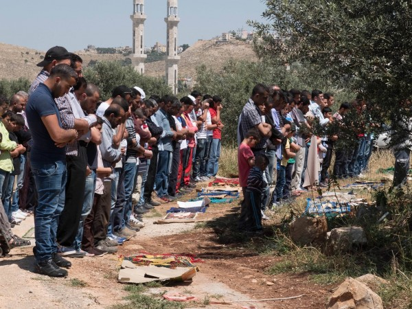 Prayers take place before the protest in Ni'lin