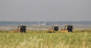 Bulldozers in the fields of Gaza
