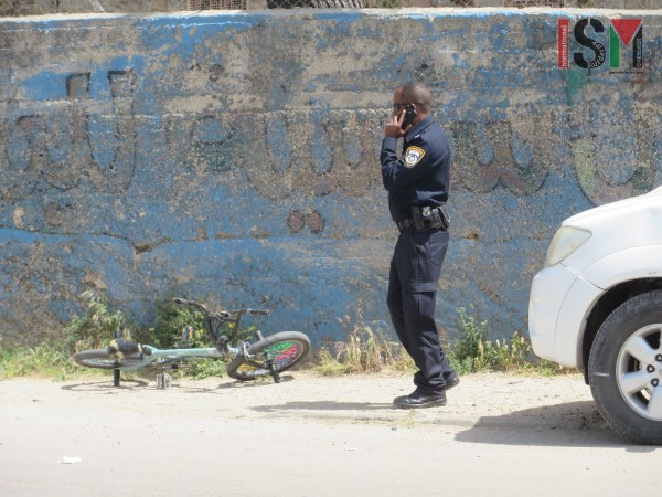 Police man next to the bicycle Ala'a was hit on