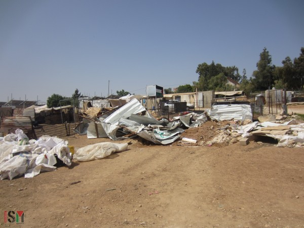 Demolished homes in Um Al-Khair