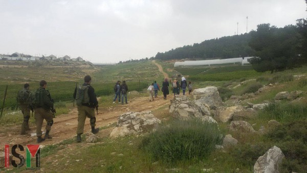 Children being escorted to school by soldiers to avoid settler attacks