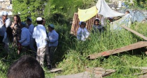 Settlers and their children trespassing illegally on Palestinian land.