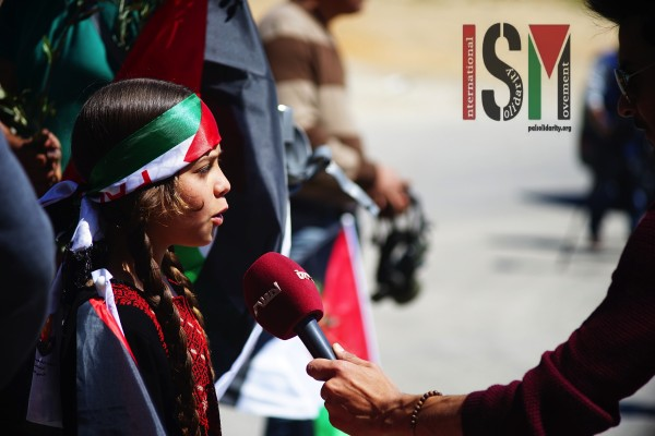 A young girl being interviewed prior to the demonstration