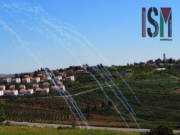 Tear gas rains down on Nabi Salih while behind sits the illegal Hamalish settlement