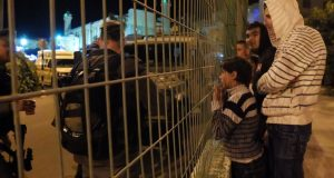 Palestinian boys excluded from celebration on their land. Photo credit: ISM