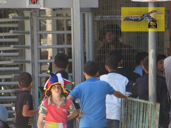 Palestinian children waiting at the checkpoint