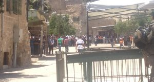 Palestinians praying outside Ibrahimi mosque