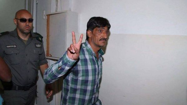 Imad Abu Shamsiyah when entering the court-house