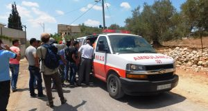 15-year old shot with live ammunition by Israeli forces loaded into ambulance