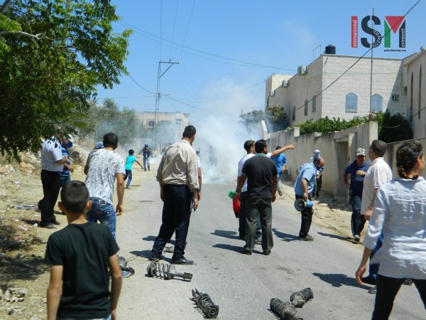 Israeli forces teargassing Paletsinian demonstrators