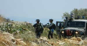 Israeli Border Police prepare to attack Palestinian teenagers and young men.