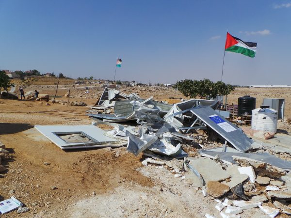 Palestinian flags fly over two of the homes that were demolished today by the Israeli military.