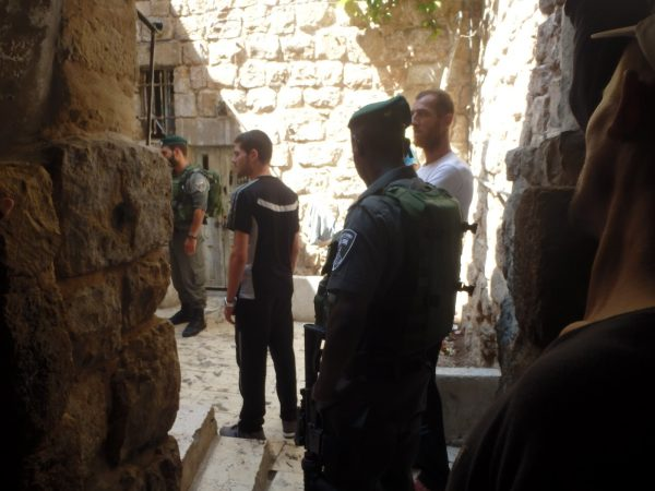 Israeli soldiers enter a Palestinian courtyard, looking for a Palestinian boy who fought with an Israeli boy.