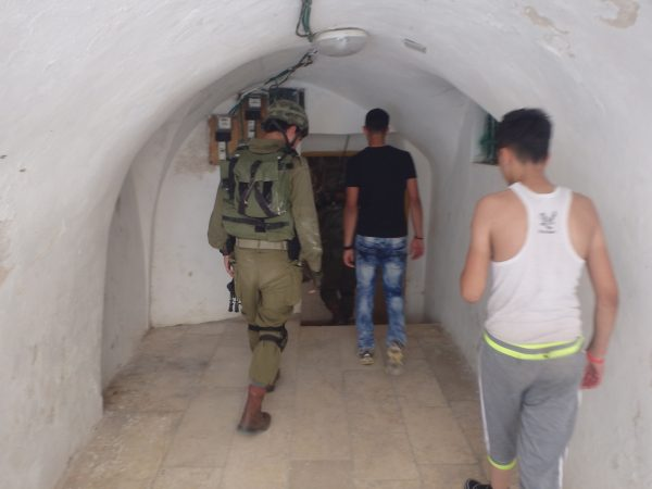 Israeli soldiers enter a Palestinian home, one of the three they invaded that day.
