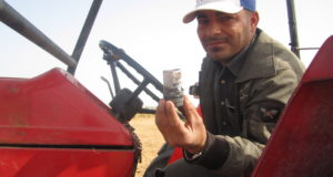 Farmer showing gas canister that was shot by Israeli forces against his tractor