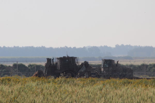 Military bulldozers destroying agricultural land