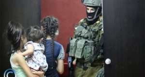 Israeli forces in Palestinian family home Photo credit: Haitham al-Khatib