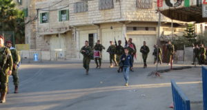 Soldiers marching through al-Khalil