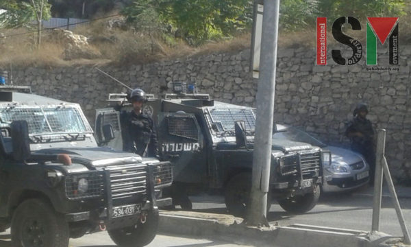 Israeli Border Police block off roads leading to the settler tour destination, doing whatever they please to modify the physical boundaries of the occupation.