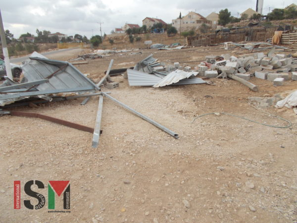 The two demolished structures - with the illegal settlement in the background