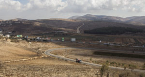 The main road to Nablus in-between the two Israeli apartheid roads. The road in the foreground leads to Bracha illegal settlement and the road seen above the main road leads to Elon Moreh settler colony.