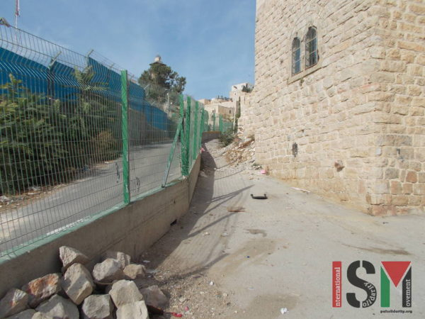 Left side of the fence for illegal colonial settlers, right side for Palestinians - often littered with trash by the settlers