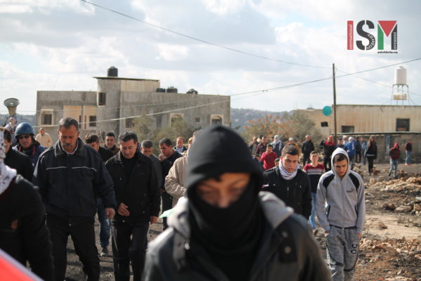 Over 100 villagers protesting apartheid wall