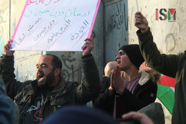 Protesters at the apartheid wall in occupied Bethlehem