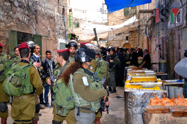 Israeli Forces escorting israeli settlers through palestinian neighbourhood