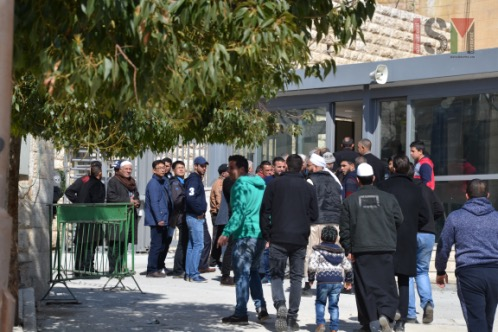 Palestinians are waiting to pass through the new checkpoint at al-Ibrahimi mosque