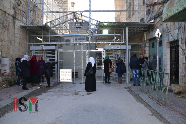 Palestinian students, teachers, and 3 officials from the NGO, Safe the Children, on their way to the Qurtuba schools, are being denied entry through Shuhada Street Checkpoint.