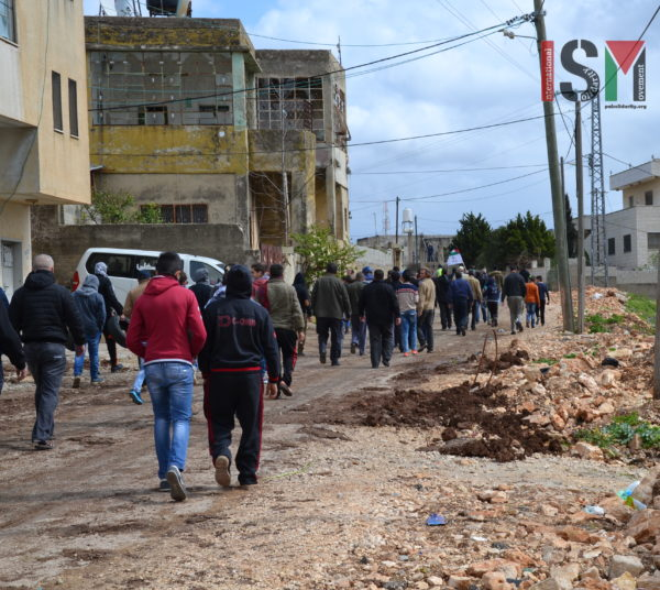 Palestinian protesters marching in Kafr Qaddoum, against the illegal closure of their road to Nablus