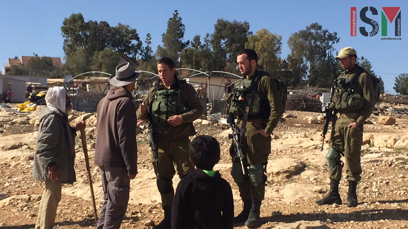 Occupation soldiers attempt to stop the work at Umm al-Khair
