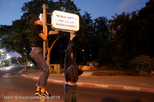 RETURN activists rename a street after murdered Palestinian medic Razan Al-Najjar.