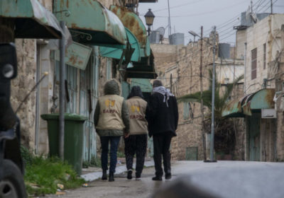 Two EAPPI members walk through Hebron with Palestinian man
