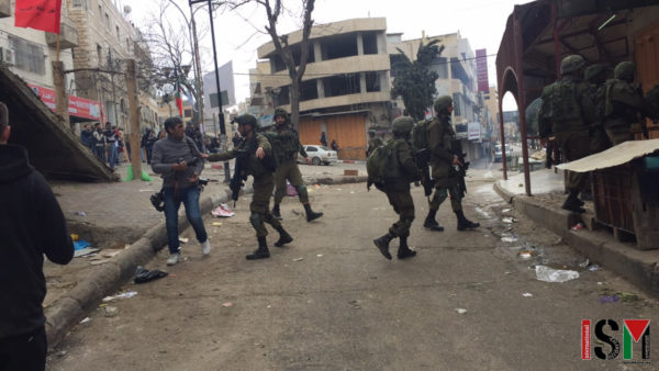 Occupation forces invading Bab Al-Zawiye, Al-Khalil