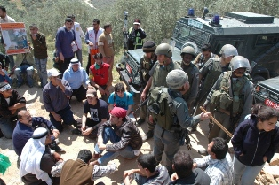 Villagers and supporters blocking jeeps