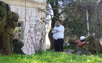 Soldiers and settlers trespass on Palestinian property